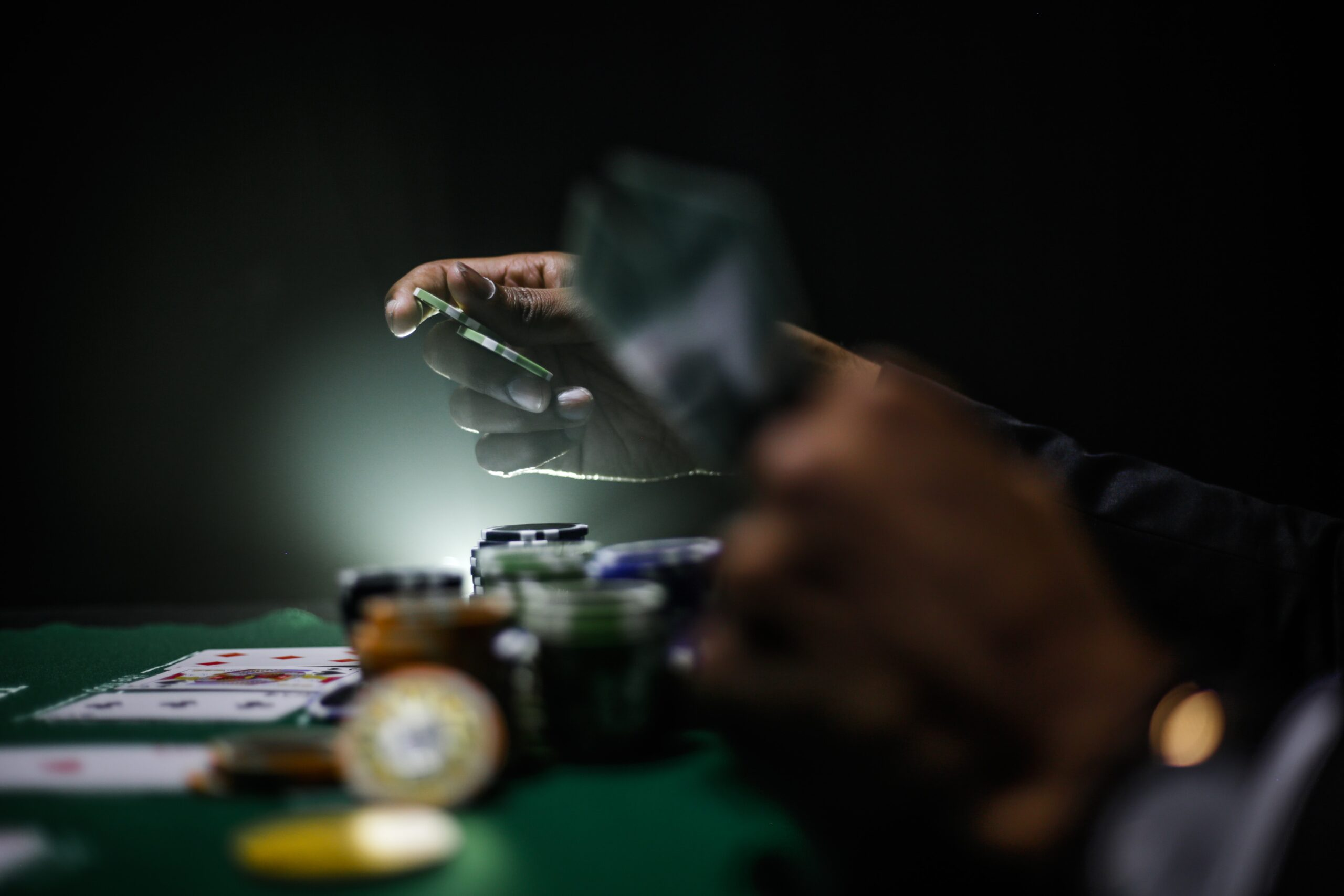 people betting with cards and bettng coins